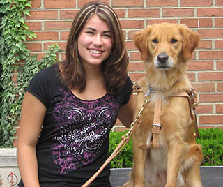 Carissa smiles with her arm around her alert and bright-eyed golden retriever named Bonnie.
