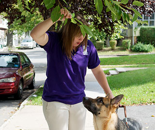 Kristin praises Cassius for alerting her to a low hanging tree branch while walking down the sidewalk.