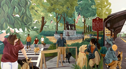 A section of the completed mural that depicts instructors training dogs and dogs with people who are blind.