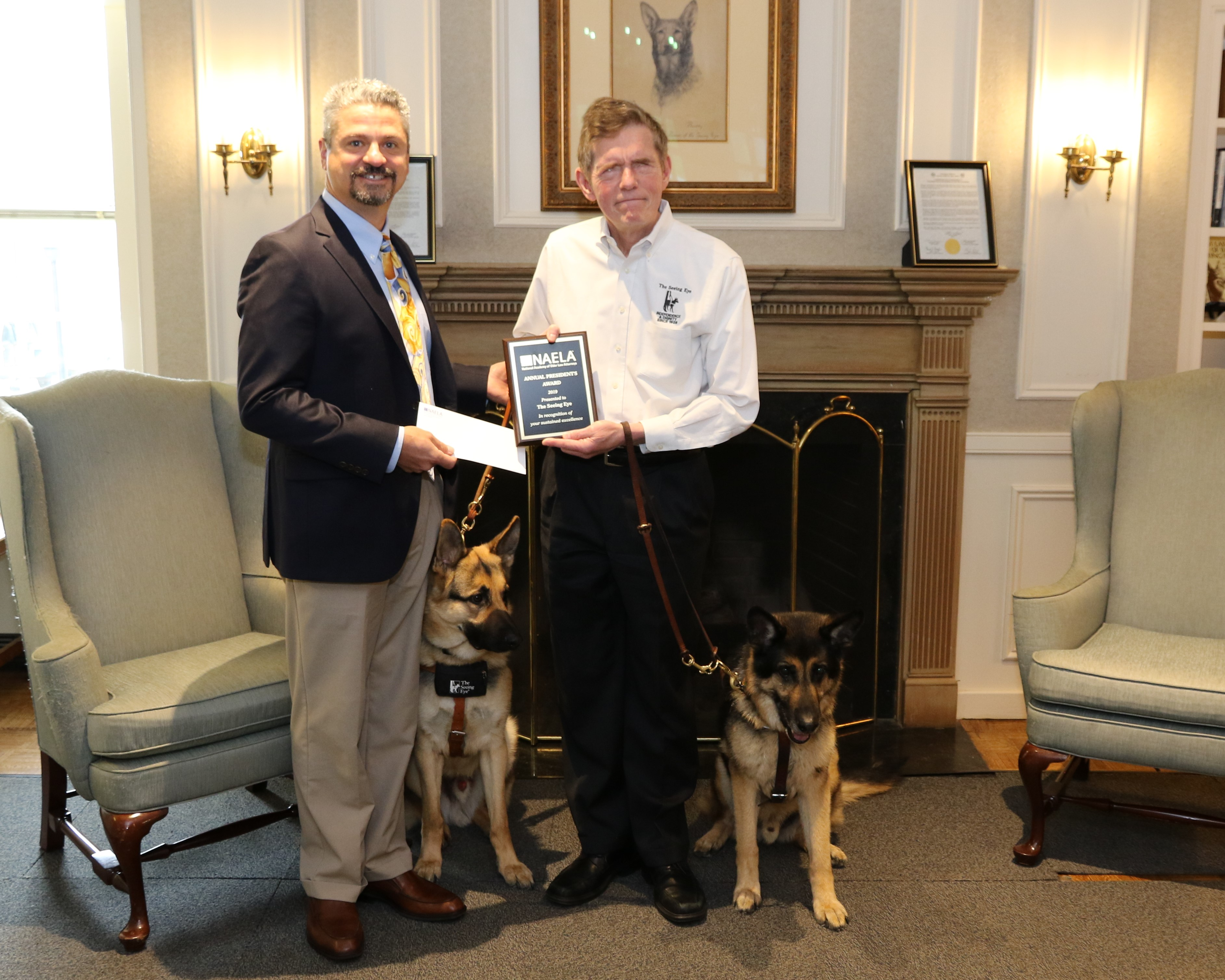 Michael Amoruso and Jim Kutsch with their Seeing Eye dogs, both German shepherds.